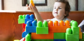 Child playing with cubes.